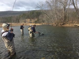 anglers working together during a learn 'n' fish trip