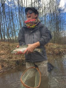 Happy female angler with a trout caught on Sugar Hollow Farm.