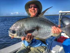 Happy angler with a nice Turneffe Flats, Belize permit